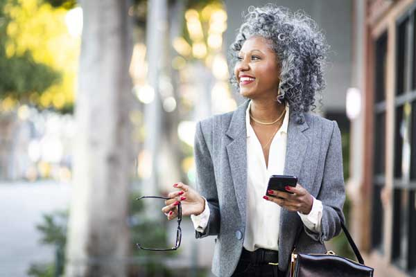 Image of women walking who is dressed in a business suit who works with Nonprofit Executive Search Services